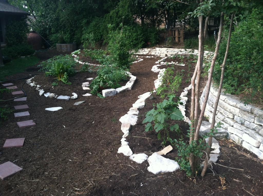 Vegetable gardens, perennials, and pathways all freshly sheet mulched. One of the best ways to build soil, increase insoak and retain moisture.